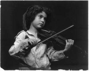 Small Child Playing Violin. Believed to be in Public Domain From Library of Congress, Prints and Photographs Collections.